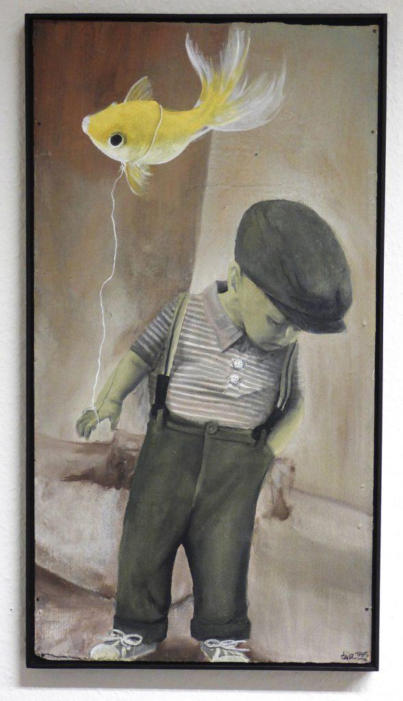 Junge mit Goldfisch
